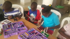 Children team up to build a 'Lift' model at La Foret Muyenga Gardens ( Below)